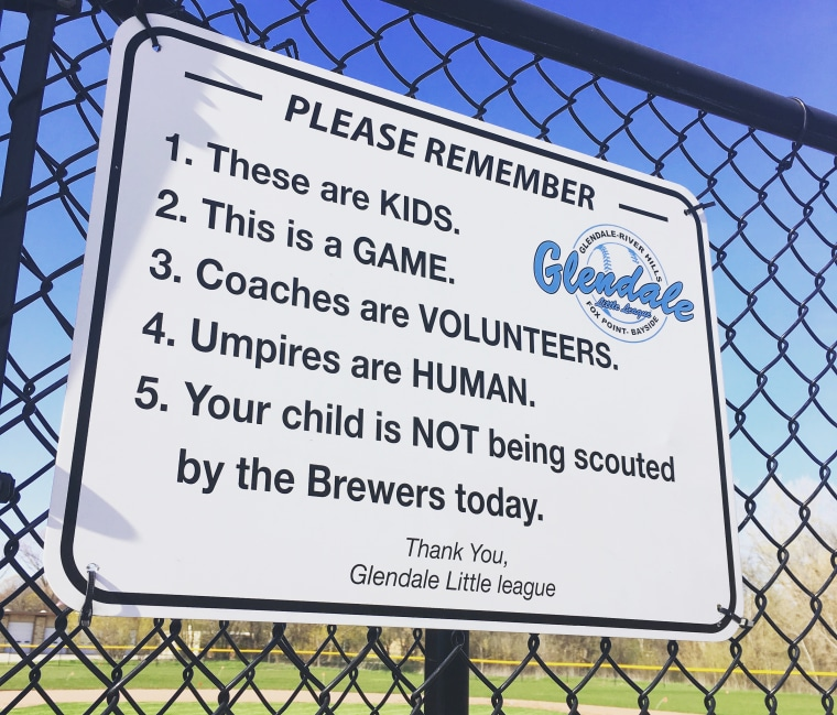 A sign reminding parents that baseball is just a game hangs in several fields where Glendale Little League plays.