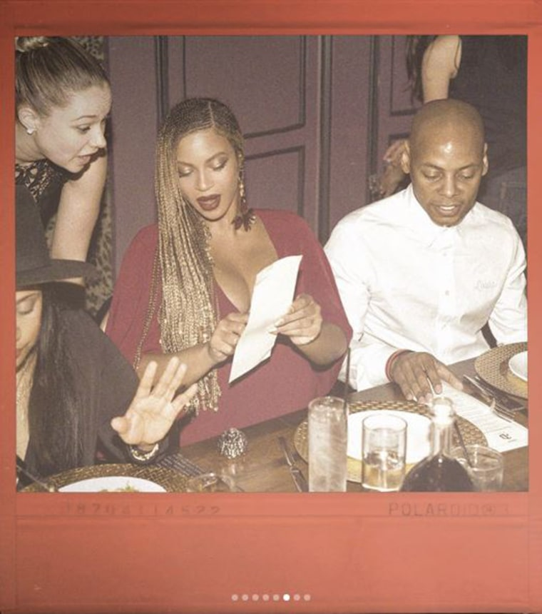 Beyonce shared this photo of herself ordering from a menu at a dinner with her husband, hip-hop star Jay Z, and several friends.