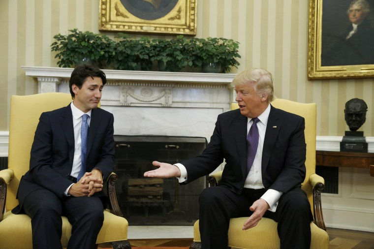 Image: Canadian Prime Minister Trudeau is greeted by U.S. President Trump at the White House in Washington