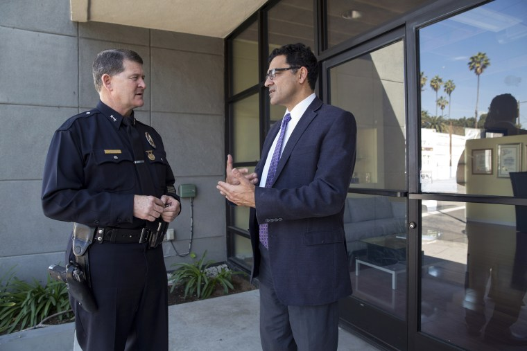 Image: Deputy Chief Michael Downing of the Los Angeles Police Department with Salam al-Marayati, director of the Muslim Public Affairs Council