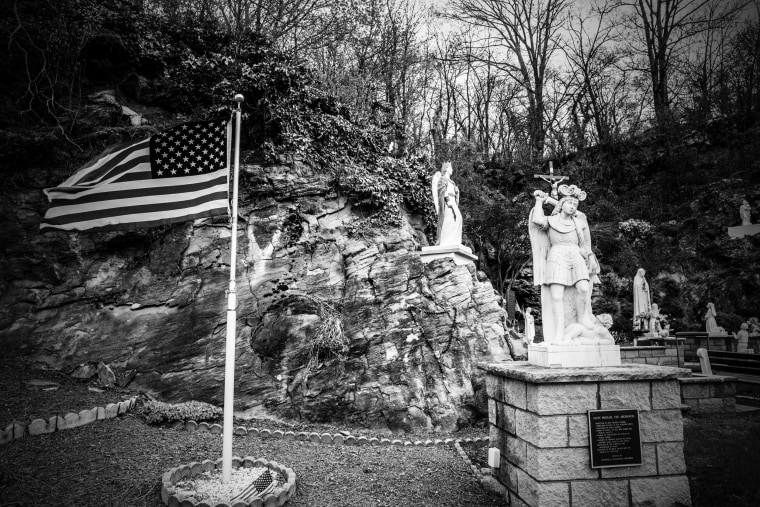 Image: Flags and figures are seen at Our Lady Of Hope Park in Wilkes-Barre.
