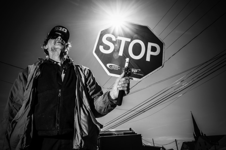 """Image: Jim Spook, a crossing guard in Ashley, speaking of President Donald Trump said,  \""""I am not a fan. I wanted Bernie. Trump only has the interests of the rich and the powerful.\"""""""