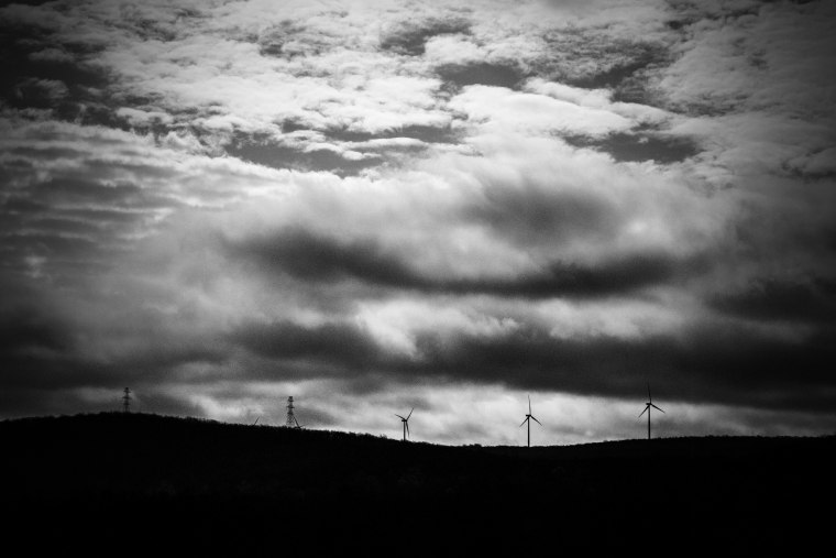 Image: Wind turbines line the horizon on the ridges above Wilkes-Barre.