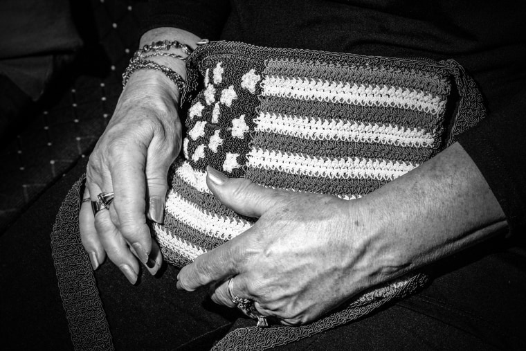 Image: A woman clutches her knitted purse as she listens at town hall meeting in Pittston, in Luzerne County.