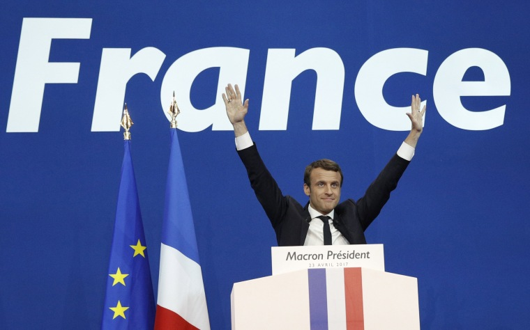 Image: French presidential election candidate Emmanuel Macron celebrates after the first round of the French presidential elections