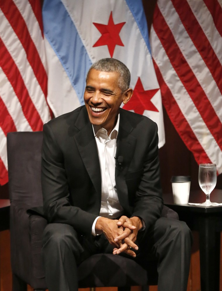 Image: Former President Barack Obama smiles as he hosts a conversation on civic engagement and community organizing
