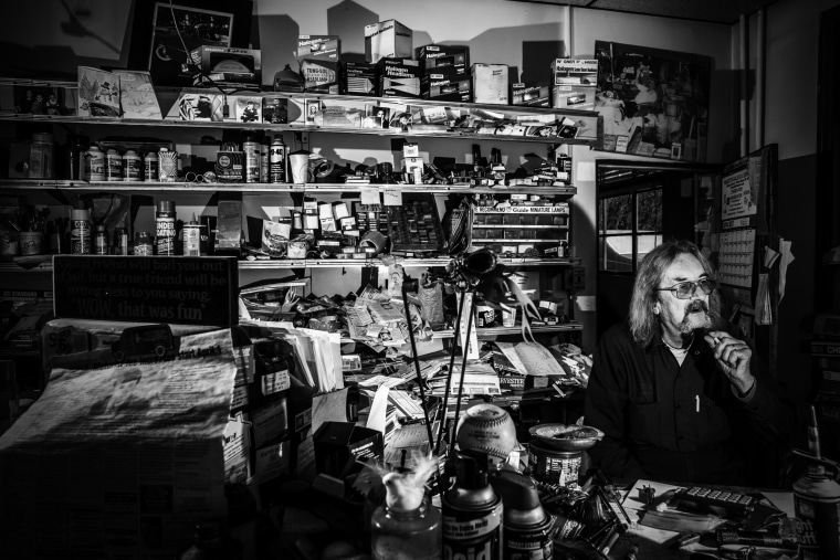 Image: Alex Bouika, 64, sits in his service station in Plymouth.