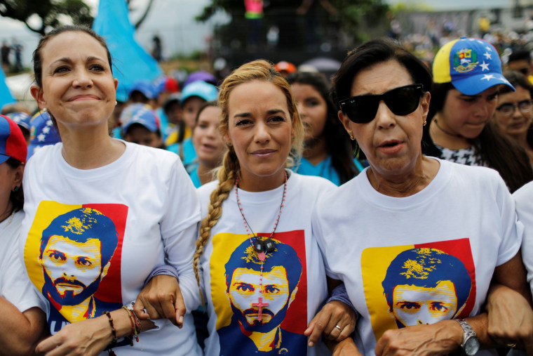 Image: Venezuelan opposition leader Maria Corina Machado, Lilian Tintori, wife of jailed opposition leader Leopoldo Lopez and Leopoldo's mother Antonieta Mendoza