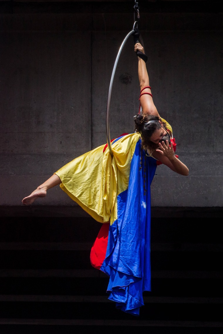 "Image: The artist Marilu Garcia performs a presentation titled \""Repressed Venezuela\"""