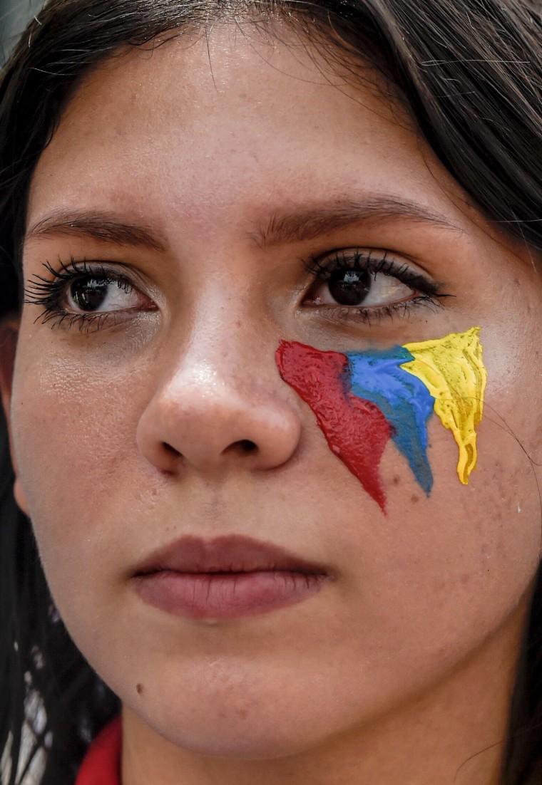 Image: A Venezuelan opposition activist marches against Venezuelan President Nicolas Maduro in Caracas