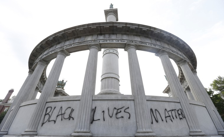 "The words ""Black Lives Matter"" spray painted on a monument to former Confederate President Jefferson Davis in Richmond, Va. June 25, 2015."