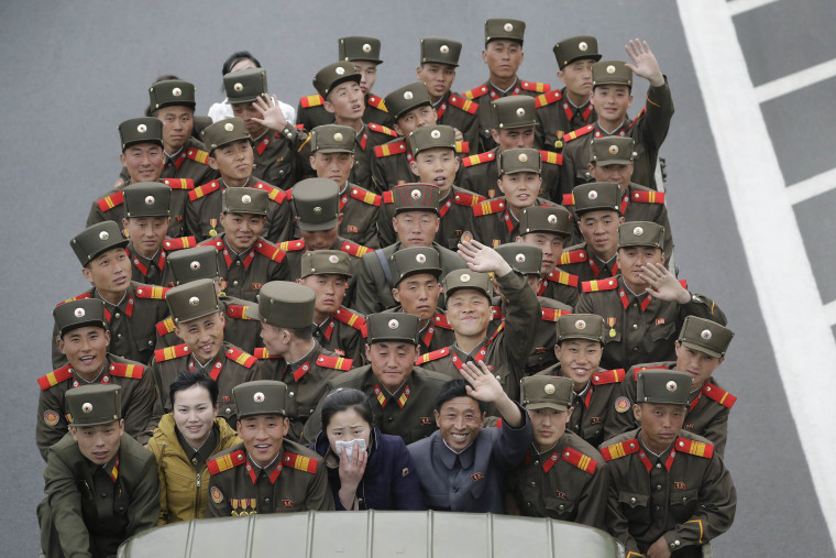 Image: North Korean military personnel sit on a truck in Pyongyang.