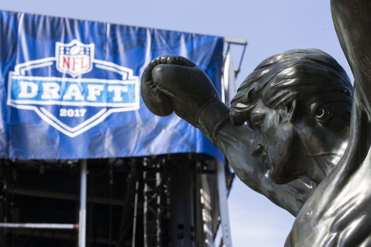 The Rocky statue stands in view of the stage being constructed for the upcoming 2017 NFL football draft on the steps of the Philadelphia Museum of Art in Philadelphia, Tuesday, April 18, 2017. (AP Photo/Matt Rourke)
