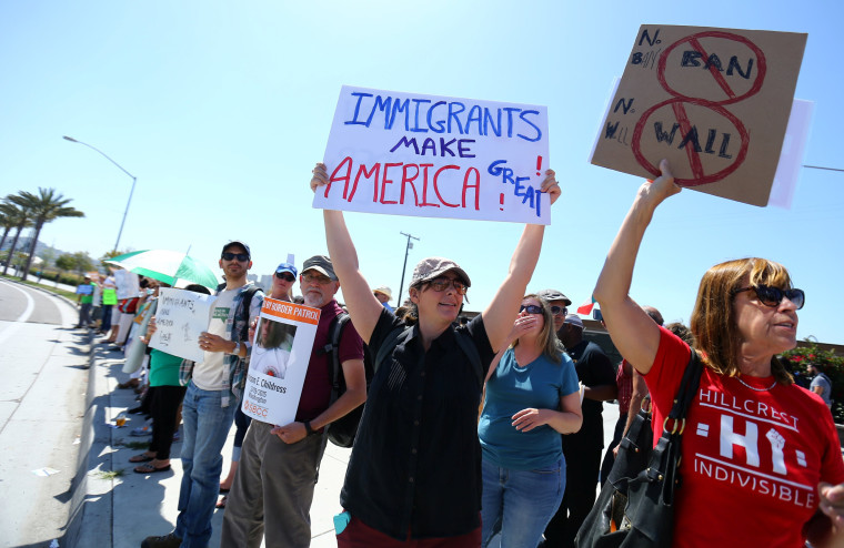 Image: Protesters at U.S.-Mexico border in San Ysidro, California