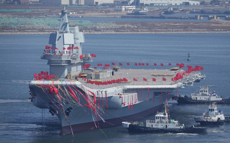 Image: China's first domestically built aircraft carrier is seen during its launching ceremony in Dalian