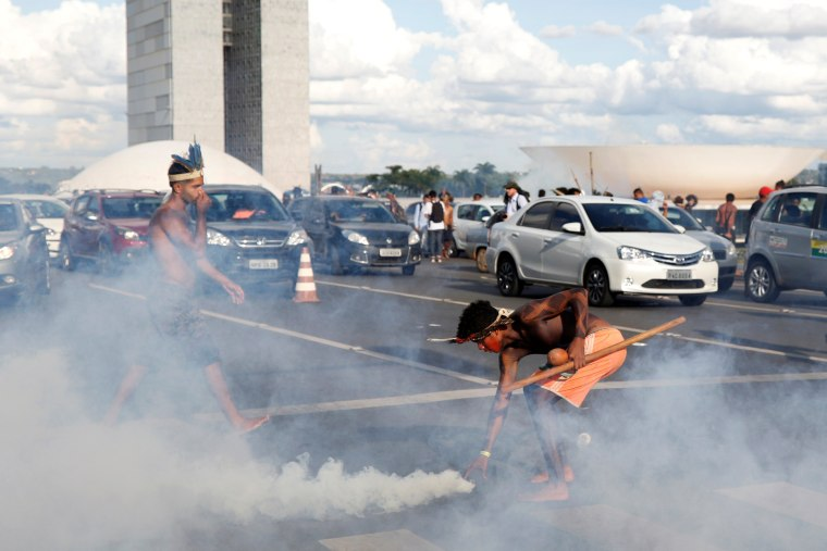 Image: Brazilian Indians take part in a demonstration against the violation of indigenous people's rights, in Brasilia