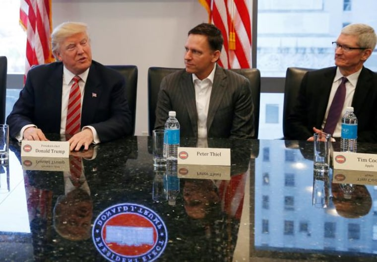 U.S. President-elect Donald Trump speaks while PayPal co-founder and Facebook board member Peter Thiel and Apple Inc CEO Tim Cook look on during a meeting with technology leaders at Trump Tower in New York