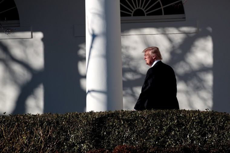 Image: President Trump walks along the west wing colonnade on his way to the Oval Office