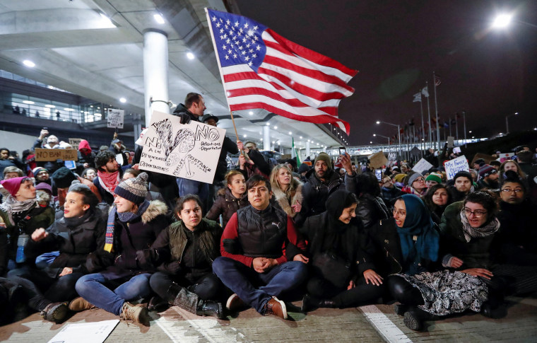 Image: People gather to protest against the travel ban imposed by U.S. President Donald Trump's executive order, at O'Hare airport