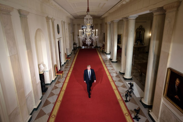 Image: President Donald Trump walks through the Cross Hall to the East Room to nominate Neil M. Gorsuch