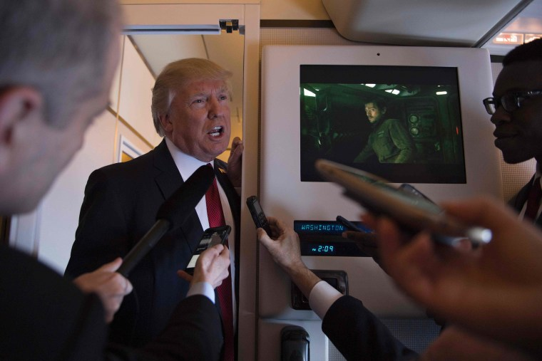 Image: US President Donald Trump speaks to the press on Air Force One