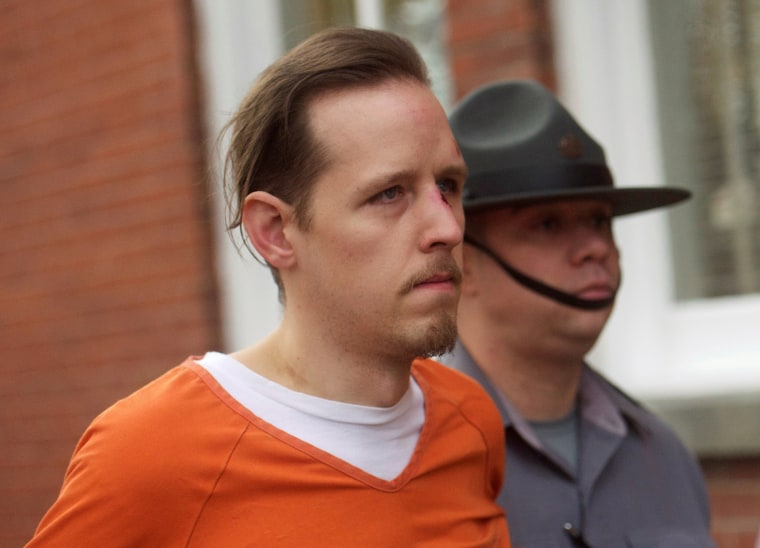 Image: Eric Frein exits the Pike County Courthouse after an arraignment in Milford