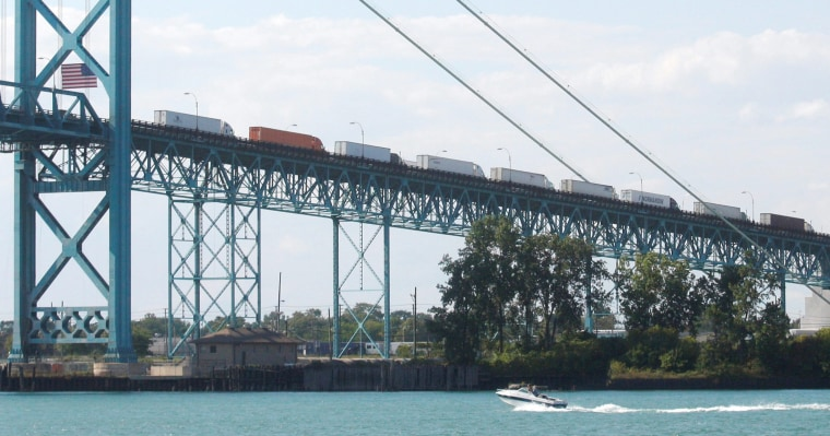 Image: Commercial trucks line up on the Ambassador bridge crossing over to Detroit, Michigan from Windsor