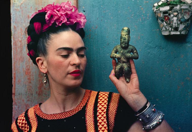 Through the Len of Nickolas Muray, Frida with Olmeca Figurine, Coyoacan, 1939