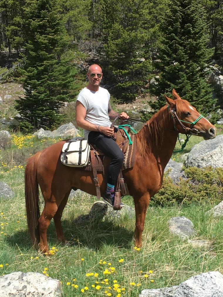Jason Arsenault horseback riding in Montana