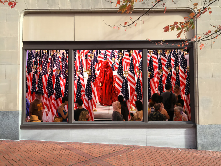 """A window mural featuring pictures from the DC showing of """"Red Chador."""""""