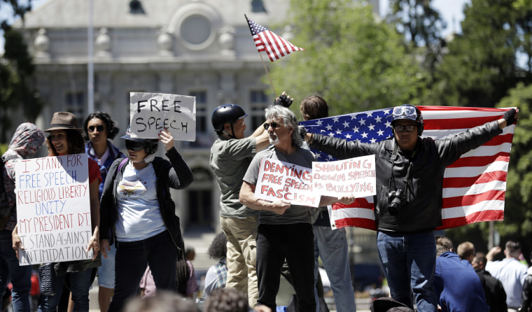 Image: Demonstrators hold signs and flags in Berkeley