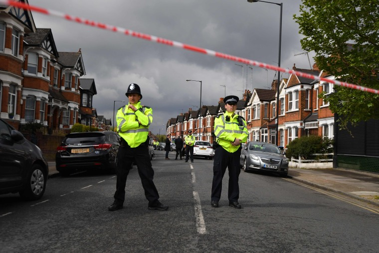 Image: Police cordon off London road after anti-terror raid