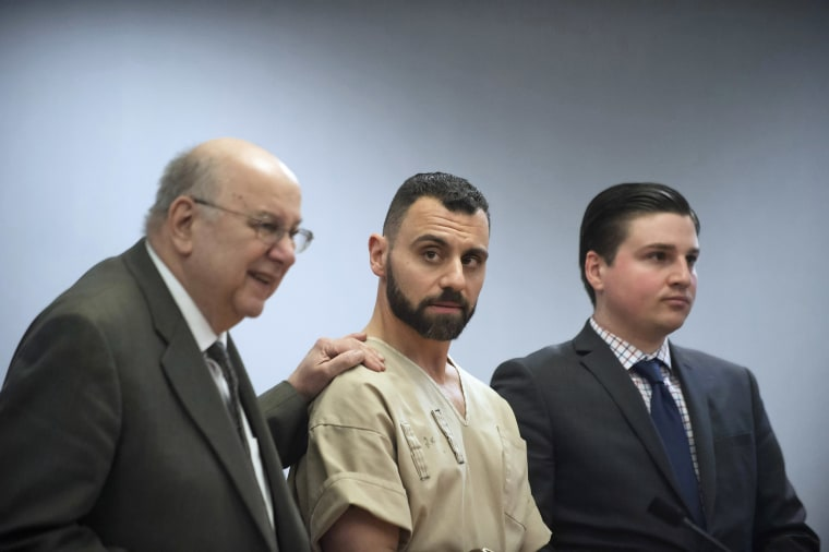 Image: Richard Dabate, center, appears with attorneys Hubie Santos, left, and Trent LaLima, right, while being arraigned