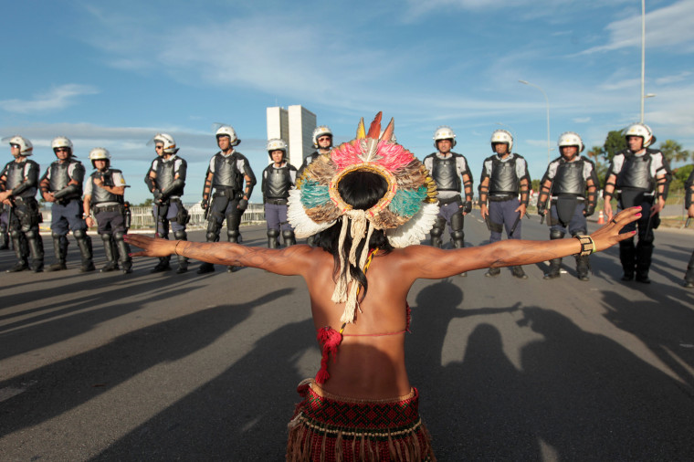 Image: An indigenous person gestures towards police in protest on April 27, 2017 in Brasilia, Brazil.
