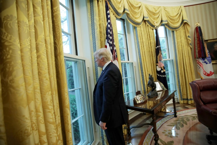 Image: President Trump Looks Out Window of the Oval Office