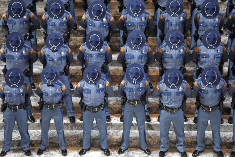 Image: New Washington State Patrol Troopers Bow Their Heads During a Prayer at Graduation