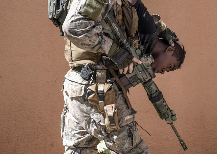 Image: A Brazilian Military Police Officer Holds a Suspected Drug Dealer During an Anti-Drug Operation
