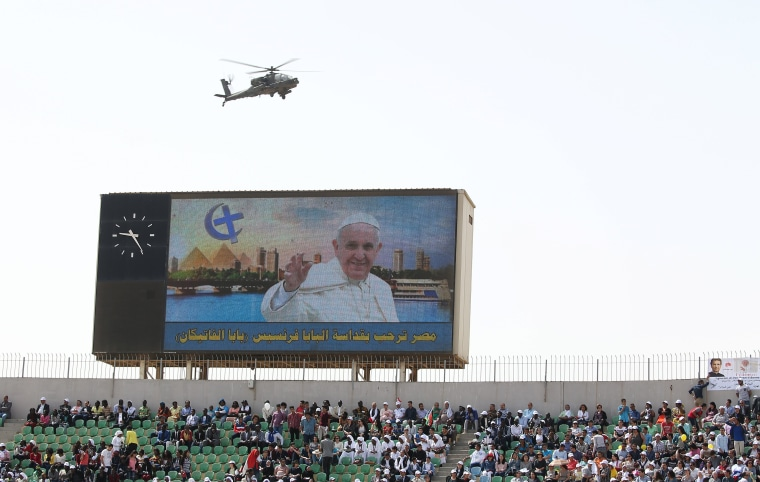 Image: A military helicopter is seen as Pope Francis leads a mass in Cairo