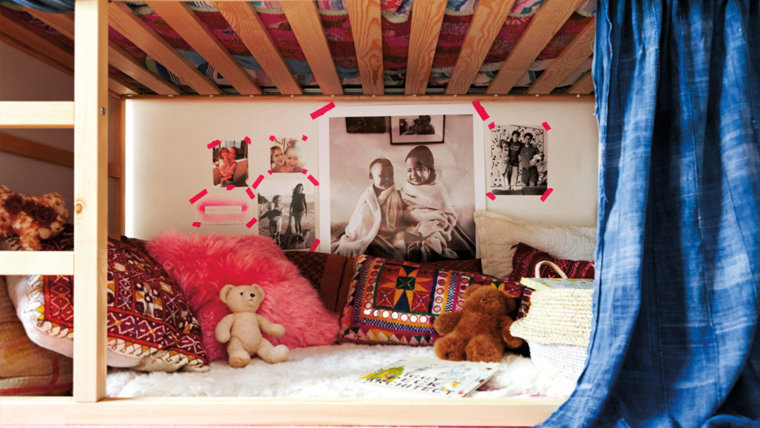 Guy uses pink tape to display her photos in a fun, creative way.