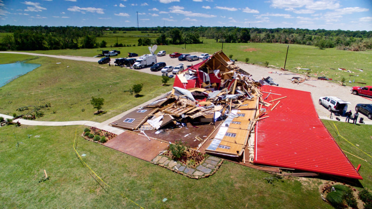 Image: The Rustic Barn, an event hall, which suffered major tornado damage, is seen from an unmanned aerial vehicle in Canton, Texas