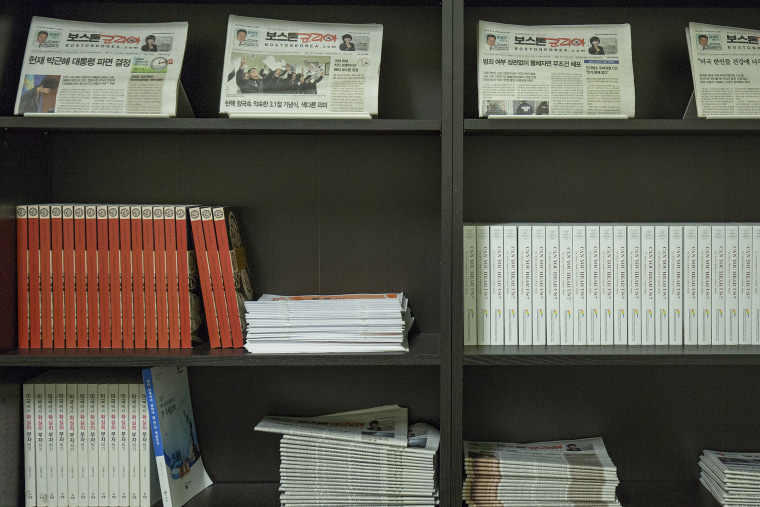 Previous issues of Boston Korea lines the walls of the newspaper office.