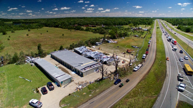 Image: Traffic slows to a crawl on Interstate 20 as onlookers take notice of tornado damage on a business, in this picture taken from an unmanned aerial vehicle in Canton, Texas