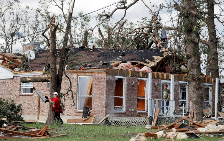 Image: Homeowners after a tornado hit the town of Canton