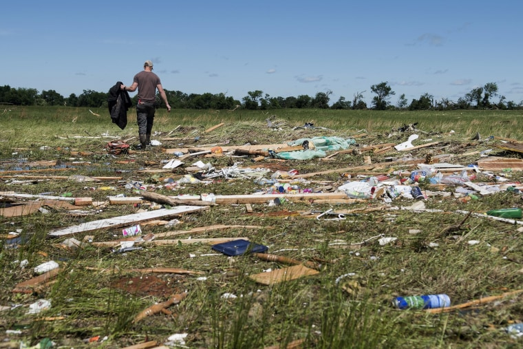 Image: Kyle Allen walks his parents' property in Canton, Texas looking for personal items