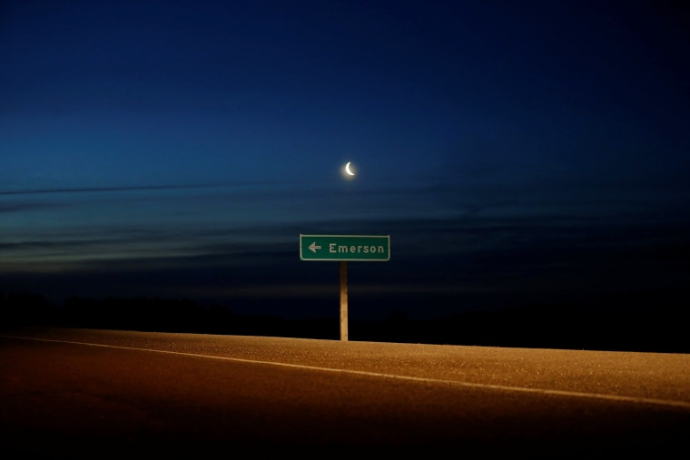 Image: A road sign pointing to Emerson near the Canada-U.S. border
