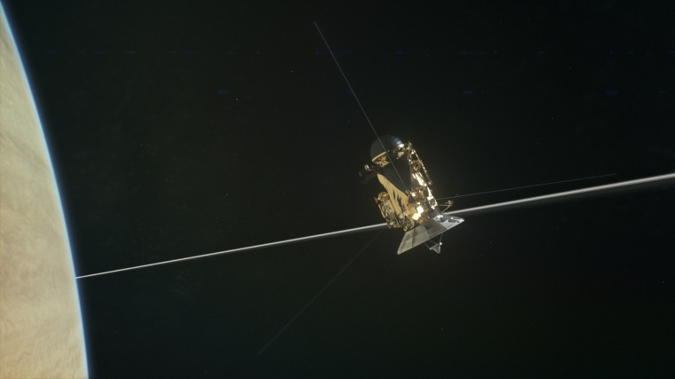 Artist's concept of the Cassini orbiter crossing through the gap between Saturn and its rings. Researchers found the previously unexplored region surprisingly empty of dust and debris, promising a smooth ride for the rest of its 22 ring dives before the spacecraft plunges into Saturn's atmosphere Sept. 15.
