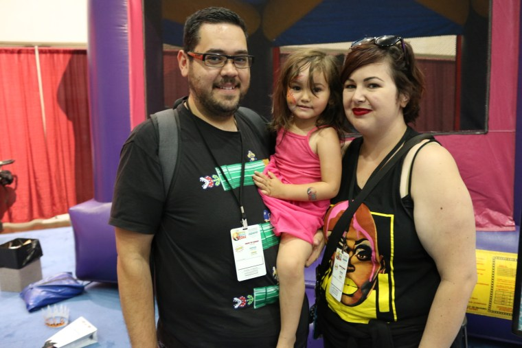 John and Marissa with their daughter at RuPaul's DragCon in Los Angeles