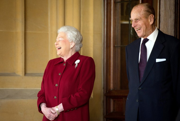 Image: FILE PHOTO: Britain's Queen Elizabeth and Prince Philip laugh after bidding farewell to the President of Ireland Michael D. Higgins and his wife Sabina at Windsor Castle in Windsor