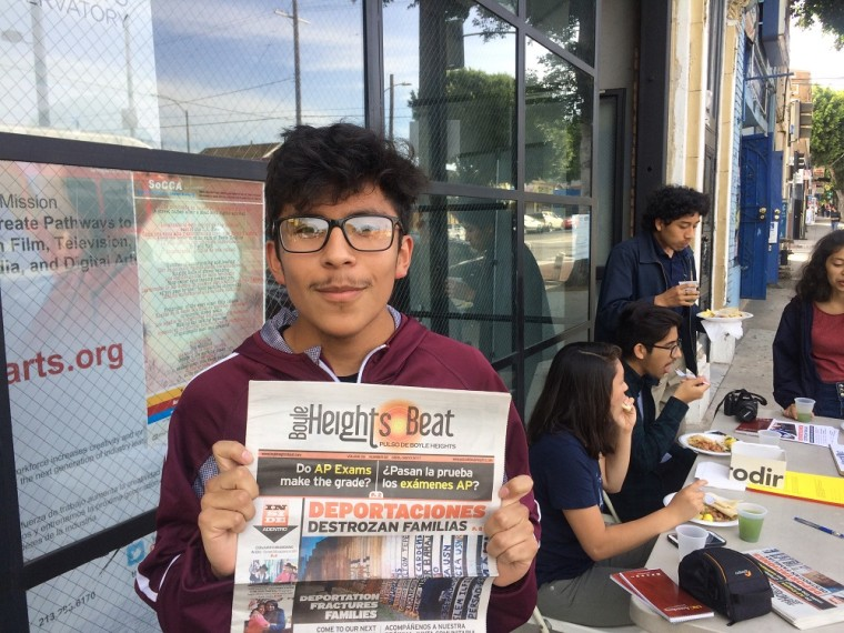 Boyle Heights Beat youth reporter Alex Medina with the latest print edition of Boyle Heights Beat.