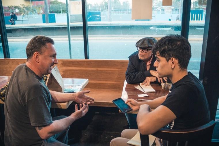 Youth reporter Josh Solis and senior editor Antonio Mejias-Rentas interview Tad Yenawine about his restaurant 'Purgatory Pizza'.